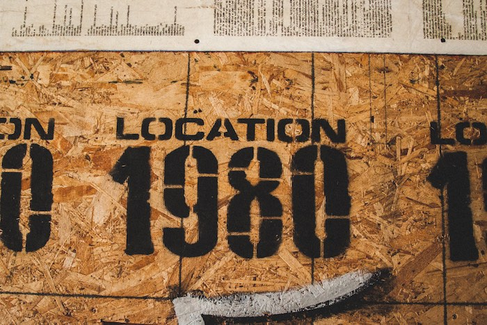 Location 1980 Stenciled On Particle Board